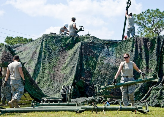 Members of the 728th Air Control Squadron move and stand up VHF and UHF antennae at Duke Field April 1 prior to a 10-day exercise. (U.S. Air Force photo/Tech. Sgt. Samuel King Jr.)