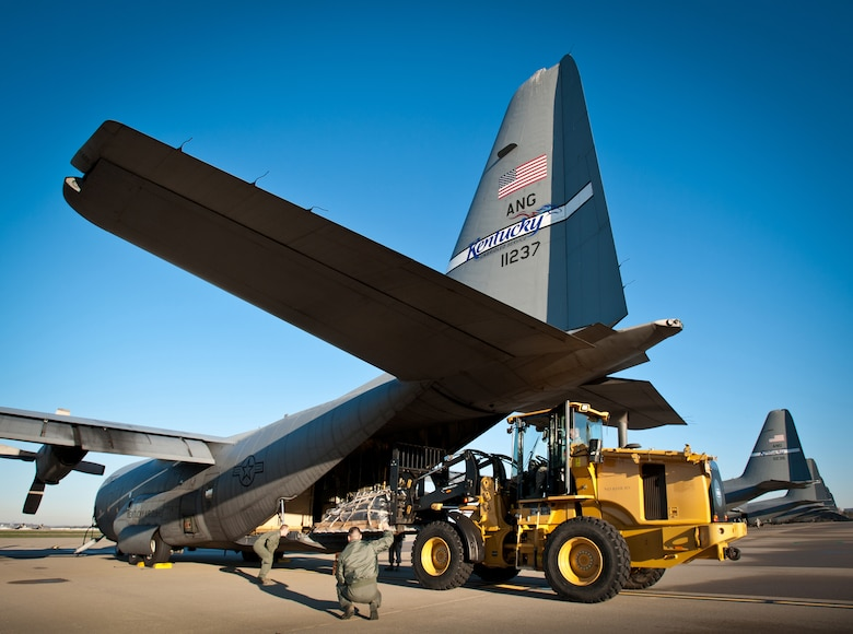Loadmasters from the 123rd Airlift Wing direct a pallet of cargo onto a C-130 aircraft on the flightline of the Kentucky Air National Guard Base in Louisville, Ky., April 2, 2011, as nearly 50 Kentucky Air Guard aircrew members, maintenance personnel and support troops prepared to deploy to San Juan, Puerto Rico, in support of Operation Coronet Oak. The mission provides vital airlift capabilities throughout the U.S. Southern Command Area of Responsibility. (U.S. Air Force photo by Maj. Dale Greer)