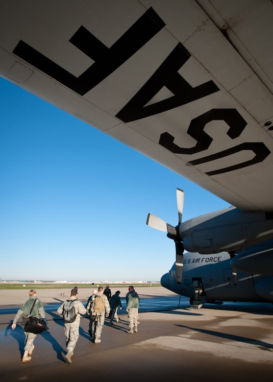 Airmen from the 123rd Airlift Wing board a C-130 on the flightline of the Kentucky Air National Guard Base in Louisville, Ky., prior to their departure April 2, 2011, for Muniz Air National Guard Base, Puerto Rico. The Airmen will be flying theater airlift missions in support of U.S. Southern Command across the Caribbean and Central and South America through Sept. 17 as part of Operation Coronet Oak. The Kentucky Air National Guard has been deploying regularly in support of Coronet Oak since it was based in Panama in the 1990s. (U.S. Air Force photo by Maj. Dale Greer)