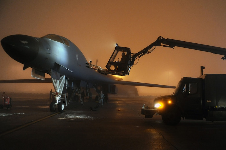 Airmen from the 34th Bomb Squadron work to de-ice a B-1B Lancer March 26, 2011, at Ellsworth Air Force Base, S.D, in preparation for a mission in support of Operation Odyssey Dawn. (U.S. Air Force photo/Senior Airman Adam Grant)