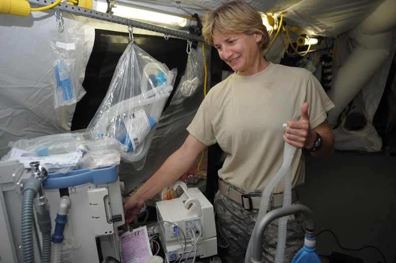 U.S. Air Force Major Bernadette Wisor, 60th Medical Group Anesthesiologist tests her equipment inside the temporary hospital facility in Cumuto Barracks at Trinidad and Tobago April 8, 2011. Wisor is a part of the Expeditionary Medical Support Health Response Team in support of the Allied Forces Humanitarian Exercise/Fuerzas Aliadas or FA HUM 2011. (U.S. Air Force photo by 2d Lt Joel Banjo-Johnson/Released)