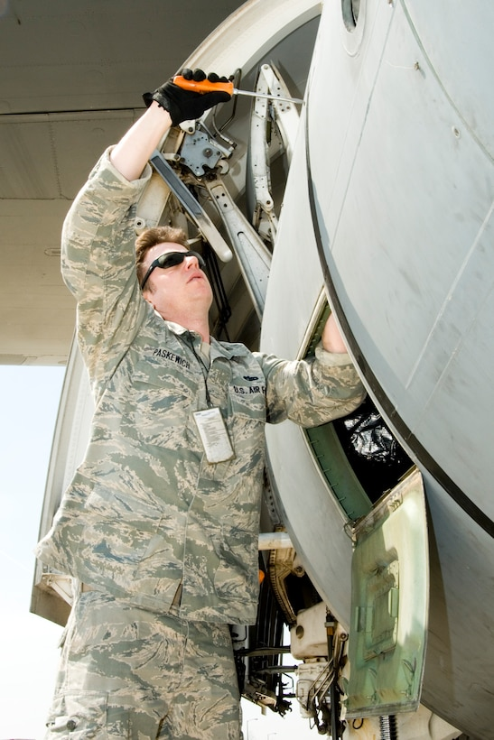 Tech. Sgt. Devon Paskewich, a crew chief at the 167th Airlift Wing, seals a panel on the side of a C-5 aircraft, at the Martinsburg, W.Va. unit on April 7, 2011. The unit's C-5 aircraft have recently supported missions in Libya, Japan, Afghanistan, and Iraq, keeping both operations and maintenance personnel busy. (U.S. Air Force photo by MSgt Emily Beightol-Deyerle)