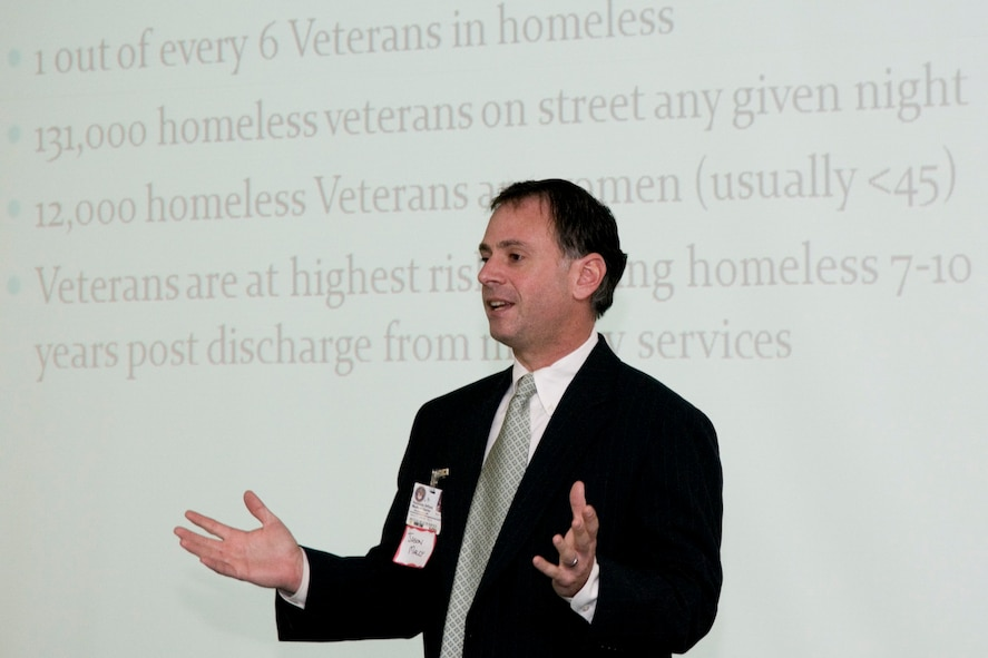 Dr. Jason Malcy, program director for the Domiciliary for Homeless Veterans  (DCHV)/GOALS program at the Veterans Administration Medical Center in Martinsburg, talks about the issue of veterans homelessness at the Inter-Service Family Assistance Committee of Eastern West Virginia's February meeting at the 167th Airlift Wing in Martinsburg. (U.S. Air Force photo by Master Sgt. Emily Beightol-Deyerle)