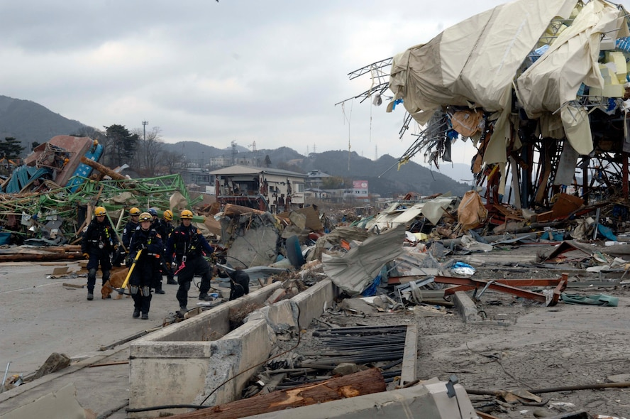 Members of the Los Angeles County Urban Search and Rescue Team, Task Force 2, move to another location on their search grid through the tsunami-ravished streets of Japan.  They travelled with the 452nd Air Mobility Wing, March Air Reserve Base, Calif., to the earthquake and tsunami stricken areas of Japan just four days after the devastation.  (U.S. Air Force photo/Technical Sgt. Daniel St. Pierre)