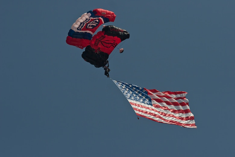 The Black Daggers U.S. Army Special Operations Command Parachute Demo Team  Drops from a C-17 Globemaster III with the U.S. Flag above nearly 100,000 spectators during the opening of the Charleston Air Expo 2011 at Joint Base Charleston April 9, 2011. (U.S. Air Force photo by Michael Dukes)