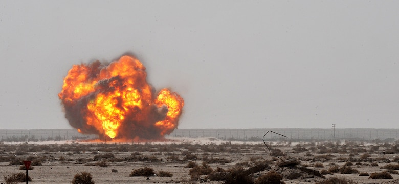 The 407th Expeditionary Operations Support Squadron explosive ordnance disposal team along with an U.S. Army EOD team successfully detonates a pile of 40 millimeter rounds and C-4 March 3, 2010, at Ali Air Base, Iraq.  (U.S. Air Force photo by Senior Airman Andrew Lee/Released)