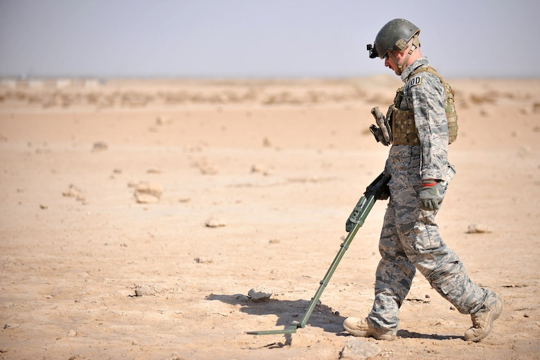 Staff Sgt. Glenn Henthorn, 407th Expeditionary Operations Support Squadron explosive ordnance disposal team chief, scans the ground with a mine and metal detector during a training exercise March 3, 2010, at Ali Air Base, Iraq. (U.S. Air Force photo by Senior Airman Andrew Lee/Released)