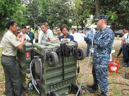 Personnel from the U.S. Marine Corps Forces Pacific Experimentation Center train service members from the armed forces of the Philippines' National Development Support Command on the operation of the Aspen 2000DM water purification system during exercise Balikatan 2011, held from March to April, at Camp Aguinaldo, Quezon City, Philippines.