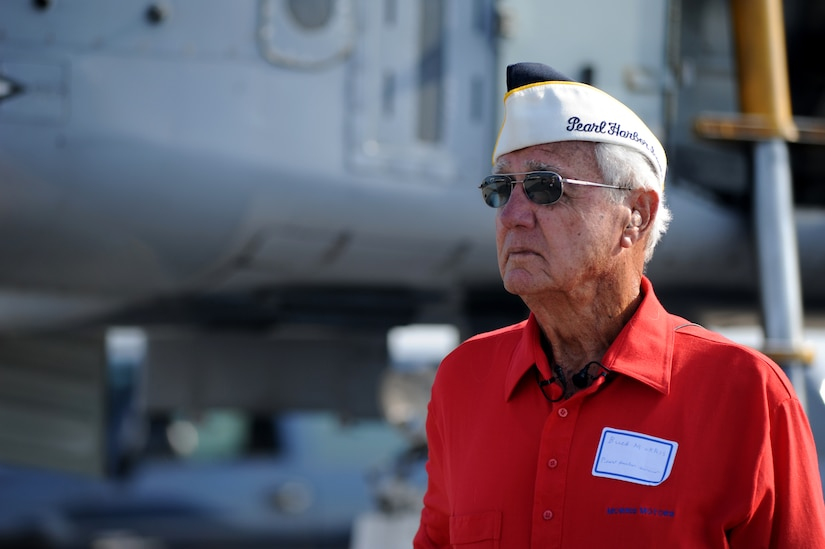 Buck Morris prepares for an interview during the Charleston Air Expo 2011  April 9.  Mr. Morris is a Navy veteran and a survivor of the attack on Pearl Harbor .  He celebrated his 89th birthday by attending the Air Expo which attracted nearly 80,000 people.  (U.S. Air Force photo/ Staff Sgt. Nicole Mickle)