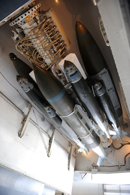 An assortment of 500-pound and 2,000-pound joint-direct-attack munitions are connected to a multiple ejector rack on a B-1B Lancer March 31, 2011, at a weapons load barn at Dyess Air Force Base, Texas. If fielded, a 16-carry modified rotary launcher will increase the number of 500-pound JDAMs and laser-guided JDAMs carried by a B-1B from 15 to 48, a 320 percent increase in capability. (U.S. Air Force photo/Airman 1st Class Shannon Hall)