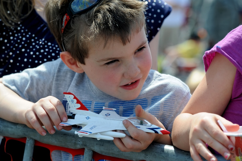 Anthony Alessandrini holds a model F-16 Thunderbird while the U.S. Air Force Thunderbirds performed for military members and their families April 8 at Joint Base Charleston, S.C. as part of Charleston Air Expo 2011. The Thunderbirds performed for nearly 80,000 people April 9 when the event was open to the public. Anthony is the four- year old son of Tech. Sgt. James Alessandrini, a Raven with the 628th Security Forces Squadron.  (U.S. Air Force photo/ Staff Sgt. Nicole Mickle)