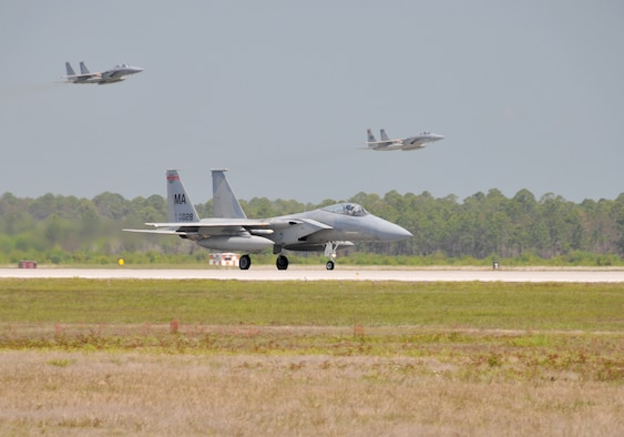 F-15 Eagles from the 104th Fighter Wing, Massachusetts Air National Guard arrive at Tyndall Air Force Base in Florida, in support of the Weapons System Evaluation Program (WSEP) on April 9, 2011. The two-week training and evaluation program is important for ground crews to test their maintenance systems and processes while loading live munitions on F-15 Eagles, as well as critical live training for the F-15 pilots to employ air-to-air missiles against remotely piloted target drones in flight. (U.S. Air Force Photo by: Master Sergeant, Mark W Fortin)
