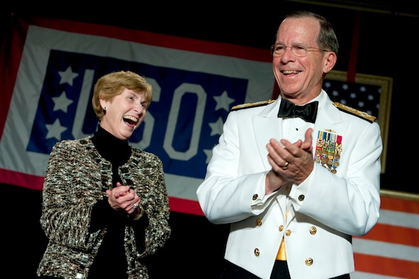 Navy Adm. Mike Mullen, chairman of the Joint Chiefs of Staff, and his wife, Deborah, share a laugh during the 2011 USO Metro Awards Dinner in Washington April 12, 2011. (Defense Department photo/Petty Officer 1st Class Chad J. McNeely)