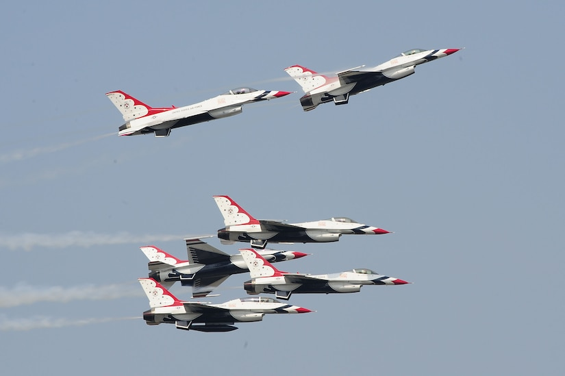 The U.S. Air Force Thunderbirds team performs a breakaway aerial maneuver during the Charleston Air Expo 2011 Apr. 9. The Thunderbirds demonstrated their precision flying for nearly 80,000 people during the Expo. (U.S. Air Force photo by Tech. Sgt. Chrissy Best)