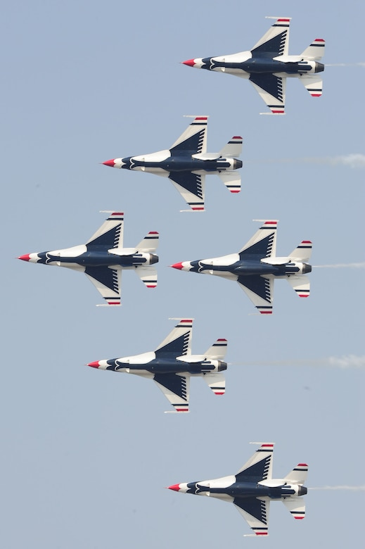 The U.S. Air Force Thunderbirds team performs a pass across airshow central during the Charleston Air Expo 2011 Apr. 9. The Thunderbirds demonstrated their precision flying for nearly 80,000 people during the Expo. (U.S. Air Force photo by Tech. Sgt. Chrissy Best)
