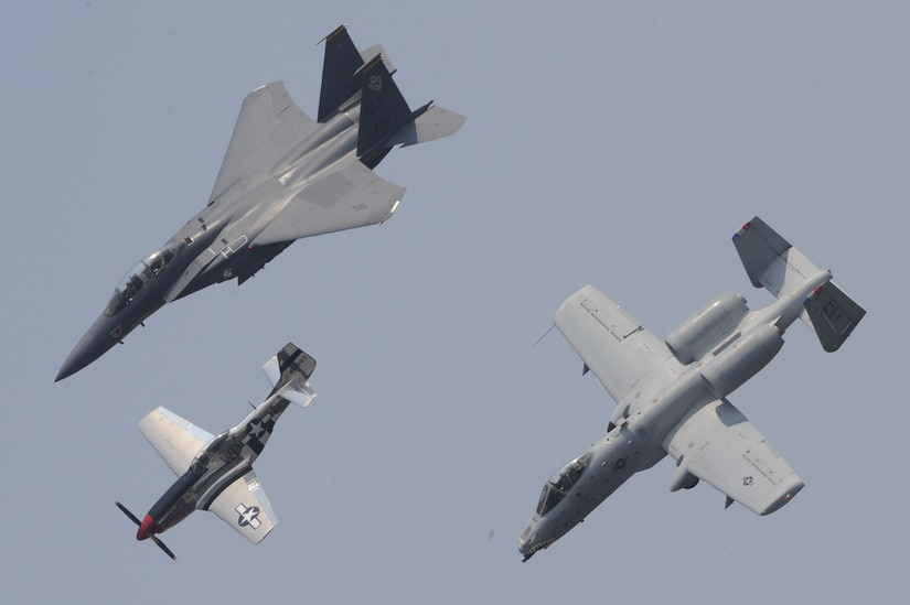 The F-15E Strike Eagle , The P-51D Mustang, and the A-10 Thunderbolt II fly in formation during the Charleston Air Expo 2011 Apr. 9. All the demonstrators showed their precision flying for nearly 80,000 people during the Expo. The three aircraft represent more than 60 years of US military air superiority. (U.S. Air Force photo by Tech. Sgt. Chrissy Best)