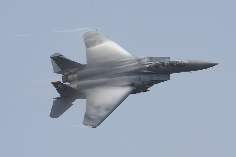 An F-15E Strike Eagle performs during the Charleston Air Expo 2011 Apr. 9. All the demonstrators displayed their precision flying for nearly 80,000 people during the Expo. The F-15E is stationed at Seymour Johnson, N.C. (U.S. Air Force photo by Tech. Sgt. Chrissy Best)