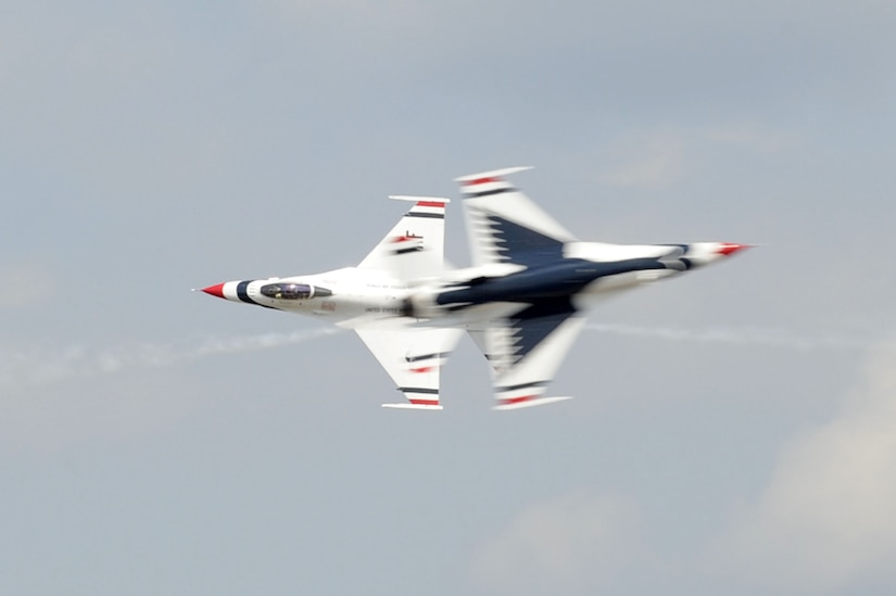 The U.S. Air Force Thunderbirds team performs an aerial maneuver during the Charleston Air Expo 2011 Apr. 9. The Thunderbirds demonstrated their precision flying for nearly 80,000 people during the Expo. (U.S. Air Force photo by Tech. Sgt. Chrissy Best)