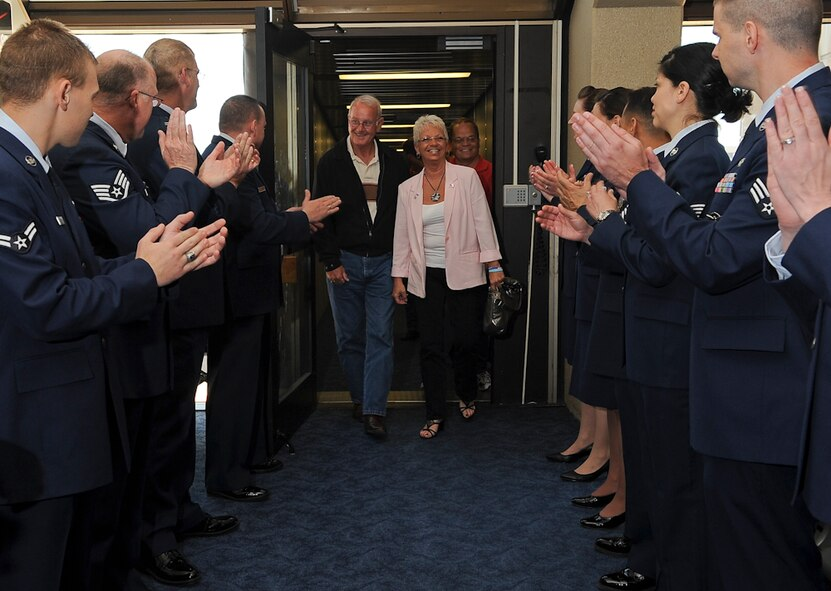 Army Command SGT Major (ret) Robert M. Patterson, Vietnam Medal of Honor recipient and his wife are welcomed by members of the 136th Airlift Wing, texas Air National Guard at DFW Airport, Dallas, Texas, April 5, 2011 for the annual MOH Parade. Sergeant Patterson received his MOH citation on Nov. 17, 2010, 41 years after the heroic act. (U.S. Air Force photo by Senior Master Sgt. Elizabeth Gilbert)