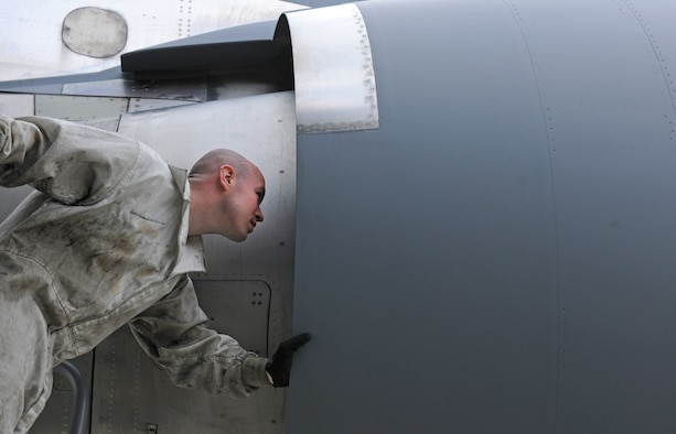 SPANGDAHLEM AIR BASE, Germany – Staff Sgt. Sean Durkin, 726th Air Mobility Squadron aircraft hydraulics journeyman, inspects a C-17 Globemaster III engine here April 12. The engine inspections are part of a comprehensive preflight inspection. The 726th AMS supports the overseas Air Mobility Command mission. (U.S. Air Force photo/Senior Airman Nathanael Callon)