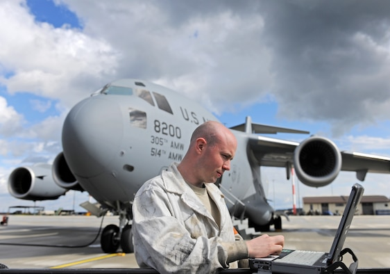 SPANGDAHLEM AIR BASE, Germany – Staff Sgt. Sean Durkin, 726th Air Mobility Squadron aircraft hydraulics journeyman, reviews a technical order prior to inspecting a C-17 Globemaster III's engines here April 12. The engine inspections are part of a comprehensive preflight inspection. The 726th AMS supports the overseas Air Mobility Command mission. (U.S. Air Force photo/Senior Airman Nathanael Callon)