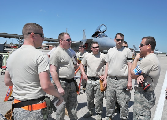 Chief Master Sergeant Robert Beaulieu, a weapons manager with the 104th Fighter Wing, Massachusetts Air National Guard, briefs his personnel before loading live missiles onto F-15 Eagles prior to live fire missions while deployed to Tyndall AFB Florida, in support of the Weapons System Evaluation Program (WSEP) on April 12, 2011. The two week training and evaluation program is important for ground crews to test their maintenance systems and processes while loading live munitions on F-15 Eagles, as well as critical live training for the F-15 pilots to employ air-to-air missiles against real world targets.