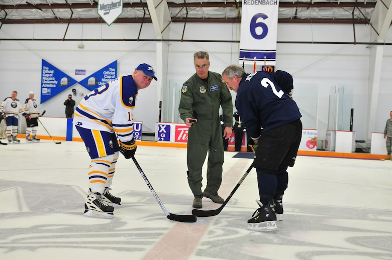 Colonel Jim McCready Commander of the 107th Airlift Wings drops the official puck to start off the Buffalo Sabers?  Alumni against Niagara Falls Air Reserves Stations Team Niagara game on April 10, 20011. Sabers Danny Gare faces off with Air Force Reserve John Rettig.(Air Force Photo/TSgt Justin Huett)