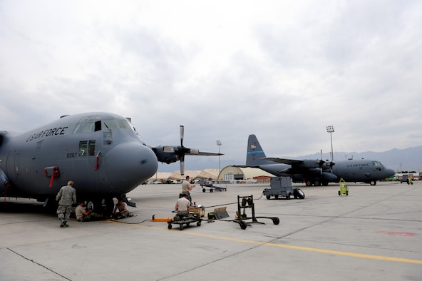 U.S. Air Force crew chiefs, from the 455th Expeditionary Aircraft Maintenance Squadron, change out the front tires on a C-130 Hercules aircraft at Bagram Airfield, Afghanistan, April 9, 2011.  The Airmen are deployed from the Delaware Air National Guard's 166th Aircraft Maintenance Squadron, New Castle, Del., supporting Operation Enduring Freedom. (U.S. Air Force photo/Master Sgt. William Greer)
