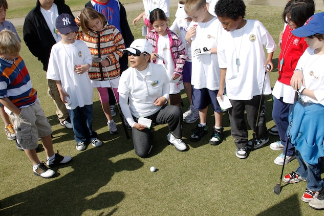 Yosuko Nishimura, a Torii Pines Golf Course specialist, explains the rules and etiquette involved with playing golf during a Junior Golf Camp hosted at the Torii Pines Golf Course here April 13. The camp focused on making the children knowledgeable and comfortable enough to play on the golf course.
