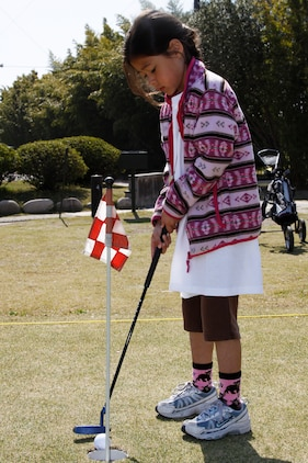 Kia Craven, a 7-year-old Junior Golf Camp attendee, practices her putting skills during a three day golf camp hosted at the Torii Pines Golf Course here April 13. Approximately 35 local children attended the golf camp.