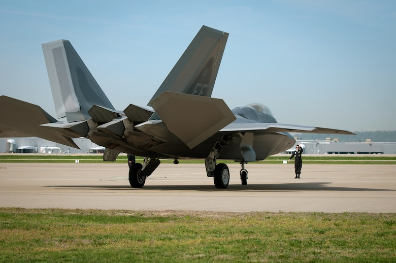 A U.S. Air Force F-22 Raptor parks at the Kentucky Air National Guard Base in Louisville, Ky., on April 14, 2011, in preparation for the Thunder Over Louisville air show. Raptors will be one of show???s marquee events when Thunder takes place over the Ohio River on April 16. The annual event has become one of the nation???s largest air shows, with nearly 60 aircraft slated to perform this year for a crowd that???s expected to top 750,000. (U.S. Air Force photo by Master Sgt. Phil Speck)