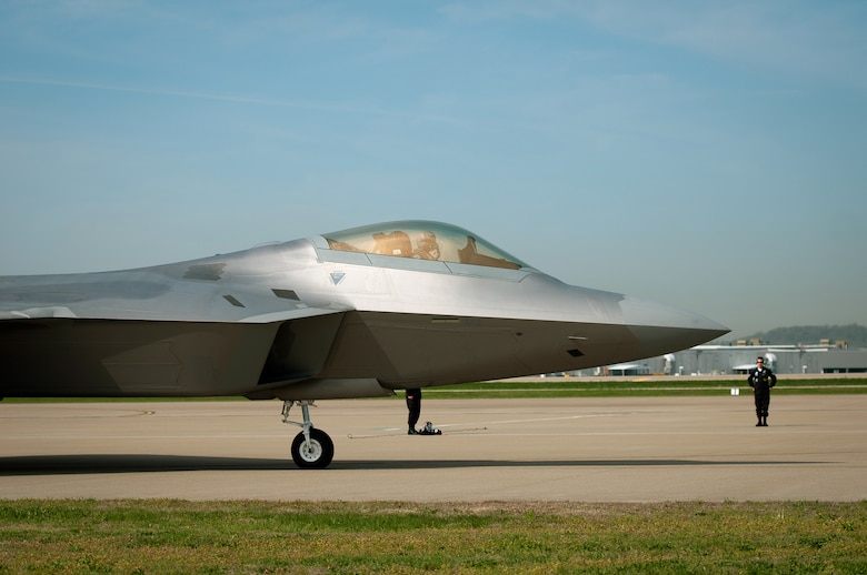 A U.S. Air Force F-22 Raptor arrives at the Kentucky Air National Guard Base in Louisville, Ky., on April 14, 2011, in preparation for the Thunder Over Louisville air show. The Raptor will be one of show???s marquee events when Thunder takes place over the Ohio River on April 16. The annual event has become one of the nation???s largest air shows, with nearly 60 aircraft slated to perform this year for a crowd that???s expected to top 750,000. (U.S. Air Force photo by Master Sgt. Phil Speck)