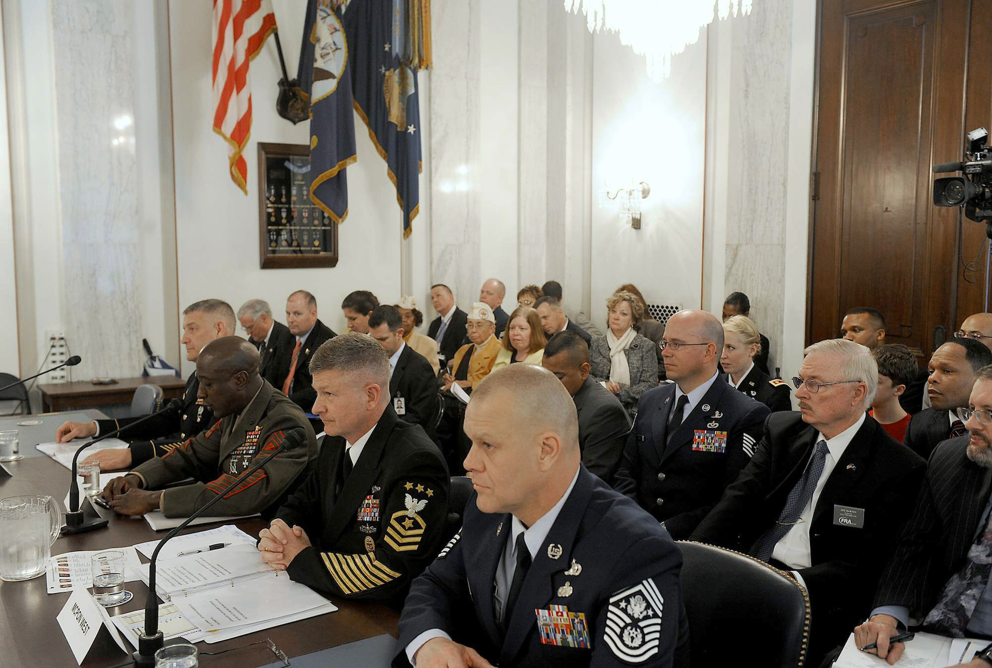 Chief Master Sgt. of the Air Force James A. Roy (right) shares the witness stand while Sgt. Maj. of the Marine Corps Carlton Kent delivers his opening statement during a Senate Armed Services subcommittee hearing on military personnel issues April 13, 2011, in Washington. Also testifying were Sgt. Maj. of the Army Raymond Chandler III and Master Chief Petty Officer of the Navy Rick West. (U.S. Air Force photo/Scott M. Ash)
