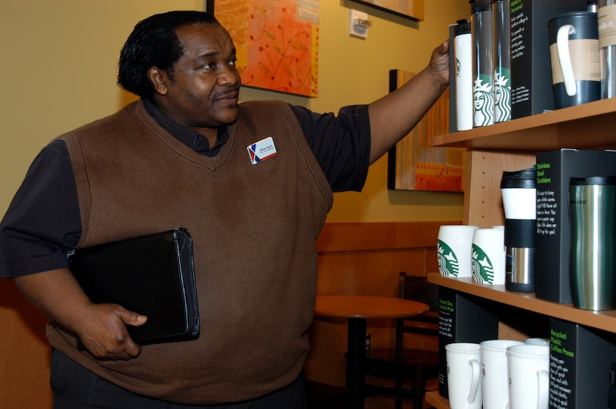 OFFUTT AIR FORCE BASE, Neb. -- Willie Taylor, the food court manager for the Offutt Exchange, inspects some merchandise at the Starbucks coffee shop inside the Base Exchange here March 16. Mr. Taylor has worked for the Army and Air Force Exchange Service for 23 years and is set to retire in April. During his AAFES career, Mr. Taylor has supported U.S. servicemembers at bases from Texas to Bosnia. He also spent 11-months supporting military members involved with Katrina relief efforts in New Orleans. U.S. Air Force photo by Staff Sgt. James M. Hodgman (Released)