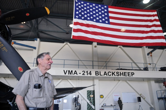 """Jim Hill, original Marine Attack Squadron 214 pilot, stands in front of an F4U-Corsair, the model he flew during World War II, during a reunion at the squadron's hangar April 14, 2011. VMA-214 hosted three of the remaining five original Black Sheep pilots, bringing the men together for the first time since 1994. All served under Medal of Honor winner and first Black Sheep commanding officer Gregory """"Pappy"""" Boyington during the squadron's first combat deployment in the Pacific in 1943."""