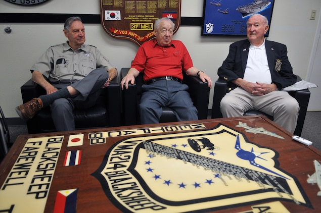"""Jim Hill, Ed Harper and Harry Johnson, all original Marine Attack Squadron 214 pilots and three of the only five still remaining, catch up with each other before speaking with media in the squadron's ready room April 14, 2011. All served under Medal of Honor recipient and first Black Sheep commanding officer Gregory """"Pappy"""" Boyington during the squadron's first combat deployment in the Pacific in 1943."""