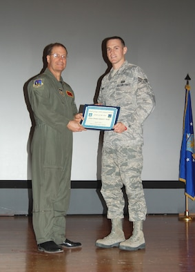 NELLIS AIR FORCE BASE, Nev. -- (Right) Senior Airman Samuel Dukes is recognized as the 926th Group's 2010 Airman of the Year by Col. Herman Brunke, 926th GP commander, during a commander's call here April 2. (U.S. Air Force photo/Capt. Jessica Martin)