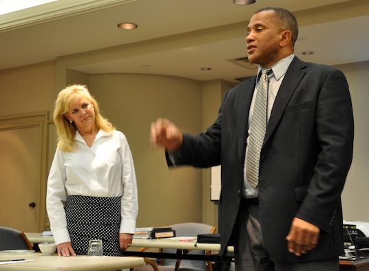 Anthony Landry and Kelly Simpson introduce themselves at the first workshop of the reintegration and marriage retreat held by the Airman and Family Readiness Center April 8-11. In addition to their training, both instructors were familiar with military life. Mr. Landry is a retired Army lieutenant colonel and Mrs. Simpson is the wife of a retired Air Force JAG. (U.S. Air Force photo/Staff Sgt. Jacob Corbin)