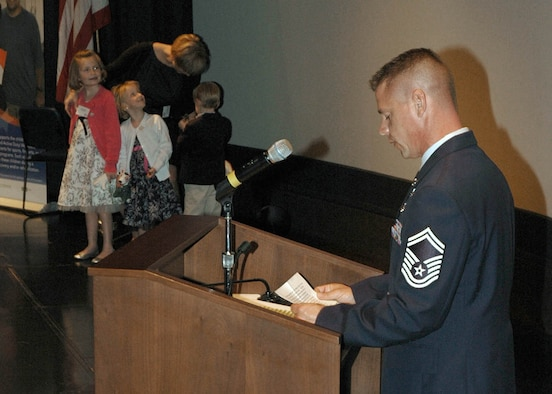 Senior Master Sgt. William Liston addresses the audience on behalf of his family at the Our Military Kids of the Year awards ceremony April 14, 2011, at the Navy Memorial in Washington. Sergeant Liston and his family were honored as the Our Military Kids Family of the Year. Our Military Kids is a nonprofit organization that provides artistic, athletic and educational grants to children of deployed National Guardsmen and military reservists. (U.S. Navy photo/Petty officer 2nd Class Patrick Gordon)
