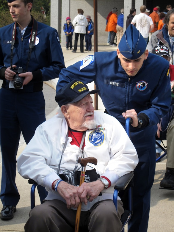 Cadet 1st Class Joseph Cortez, Cadet Squadron 25, assists World War II veteran Fred Linke during their visit to the U.S. capital April 7-9. (U.S. Air Force Photo)