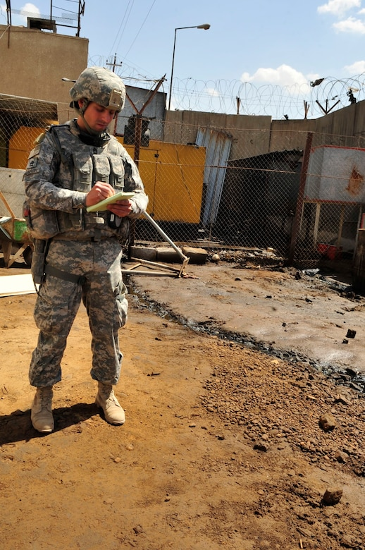 U.S. Army Sgt. 1st Class Todd Berenson, U.S. Forces – Iraq provost marshal office corrections assistance transition team force engineer assessor, takes notes outside near a power generator producing electricity for a prison in Baghdad's Rusafa Prison Complex, April 6, 2011. Sergeant Berenson took note of an unsafe condition with fuel spillage coming from a tank next to the generator. He made his observation during an assessment of conditions at the facility. (U.S. Air Force photo by Senior Master Sgt. Larry A. Schneck)