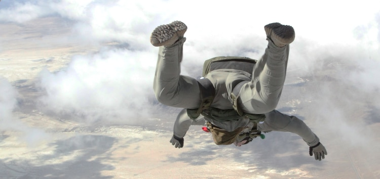 A jumpmaster with U.S. Marine Corps Forces, Special Operations Command, conducts a freefall jump during a Double-Bag Static-Line parachute course in Wendover, Utah, April 9 - 21. The course was taught by personnel from the 2nd MSOB paraloft and the Airborne Mobile Training Team, and is designed to give Marines a basic understanding of HAHO operations.