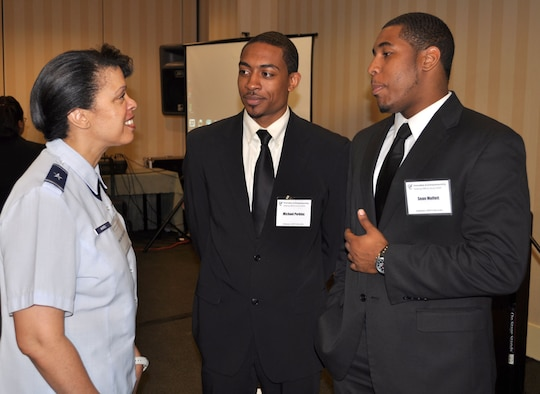 Brig. Gen. Stacey Harris, mobilization assistant to the Commander, U.S. Africa Command, talks with Michael Perkins and Sean Moffett, Alabama A & M University, during the Innovation and Entrepreneurship Challenge in Atlanta April 15, 2011. General Harris served as a judge during the eleventh annual event and used the opportunity to get to know students after they presented a business plan to demonstrate their entrepreneurial skills.