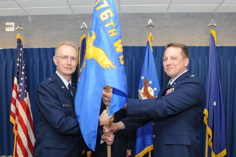 JOINT BASE ELMENDORF-RICHARDSON, Alaska ? Lt. Col. Mark Hedlund from the Joint Forces Headquarters, Alaska, Alaska Air National Guard on Fort Richardson accepts the command of the 176th Maintenance Group, Alaska Air National Guard from Brig. Gen. Charles Foster, commander of the 176th Wing, April 17, 2011. Hedlund recently served as the state director of operations and director of staff and is familiar with the 176th Wing, having previously served as commander of its 144th Airlift Squadron, deputy commander of its 176th Operations Group, and in a variety of other roles. Alaska Air National Guard photo by Master Sgt. Shannon Oleson.