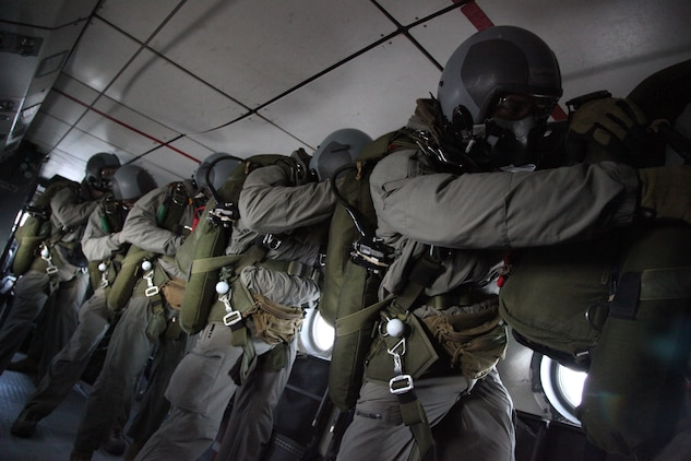 Marines with 3rd Marine Special Operations Battalion, U.S. Marine Corps Forces, Special Operations Command, check each others' gear before conducting a High Altitude, High Opening jump as part of a Double-Bag Static-Line parachute course in Wendover, Utah, April 9 - 21. The course was taught by personnel from the 2nd MSOB paraloft and the Airborne Mobile Training Team, and is designed to give Marines a basic understanding of HAHO operations.
