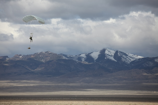 A Marine with 3rd Marine Special Operations Battalion, U.S. Marine Corps Forces, Special Operations Command, conducts a High Altitude, High Opening jump as part of a Double-Bag Static-Line parachute course in Wendover, Utah, April 9 - 21. The course was taught by personnel from the 2d MSOB paraloft and the Airborne Mobile Training Team, and is designed to give Marines a basic understanding of HAHO operations.::r::::n::::r::::n::::r::::n::
