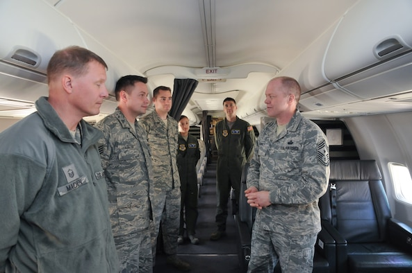 Command Chief Master Sgt. Christopher Muncy, Air National Guard Command Chief Master Sergeant, talks with crewmembers from the 201st Airlift Squadron during a visit to District of Columbia Air National Guard, April 17, 2011. The Chief was invited to talk with the Airmen of the unit as well as visit different workspaces to get a better idea of the 113th Wing mission. (U.S. Air Force photo by Master Sgt. Dennis Young)