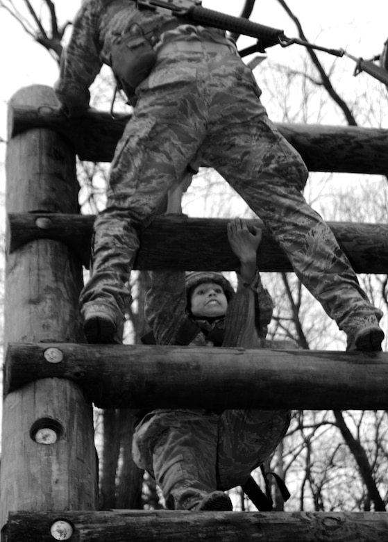 Cadet 3rd Class Dominique Amor climbs one of 11 obstacles the Air Force Sandhurst team had to complete during that portion of the Sandhurst Competition Saturday, April 16, 2011 at the U.S. Military Academy, N.Y.  The competition requires each team to perform a series of challenging military tasks along a 7-mile route, and compete in a marksmanship competition.  The team only had a rough idea of what to train for as most of the challenges were kept secret until the day of the event.  (U.S. Air Force photo/Staff Sgt. Raymond Hoy)