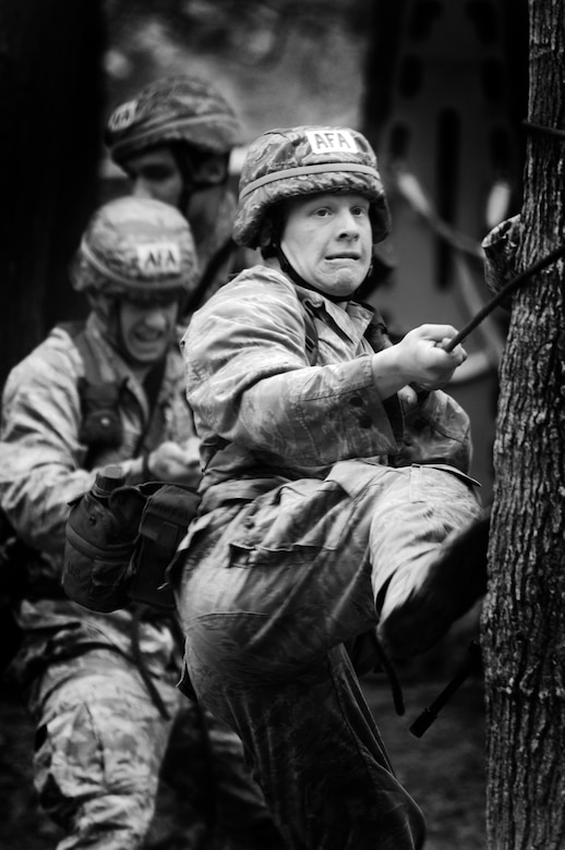 Cadet 2nd Class William Friedl and his team secure a rope to a tree during the rope bridge portion of the Sandhurst Competition Saturday, April 16, 2011 at the U.S. Military Academy, N.Y.  The competition requires each team to perform a series of challenging military tasks along a 7-mile route, and compete in a marksmanship competition.  The team only had a rough idea of what to train for as most of the challenges were kept secret until the day of the event.  (U.S. Air Force photo/Staff Sgt. Raymond Hoy)