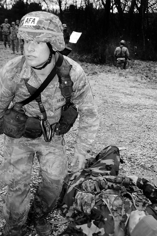 Cadet 3rd Class William Friedl renders aid to a simulated casualty during the first aid portion of the Sandhurst Competition Saturday, April 16, 2011 at the U.S. Military Academy, N.Y.  The competition requires each team to perform a series of challenging military tasks along a 7-mile route, and compete in a marksmanship competition.  The team only had a rough idea of what to train for as most of the challenges were kept secret until the day of the event.  (U.S. Air Force photo/Staff Sgt. Raymond Hoy)